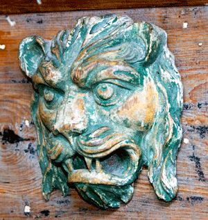 carved wooden lion's head from the corner of a Barnum & Bailey circus wagon